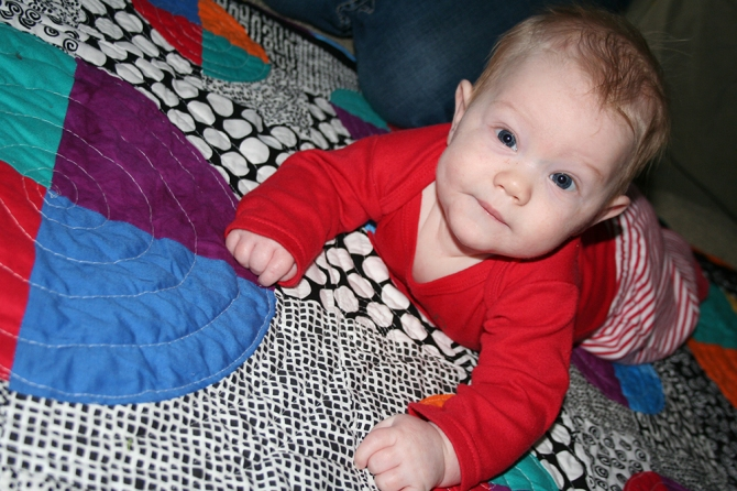 Evan on his new quilt